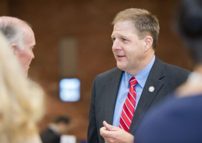 Gov. Chris Sununu speaks with Keynote Speaker James Sandman, President of the Legal Services Corporation