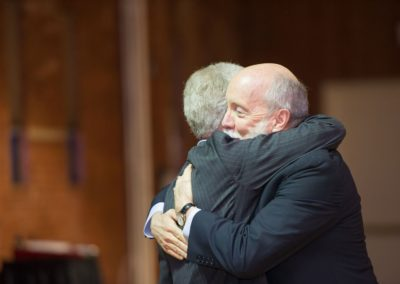 Gordon MacDonald embraces former NHLA Executive Director John E. Tobin, Jr.